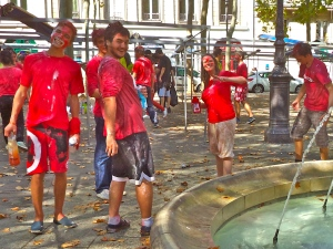 The Reds, claiming a win, refill their bottles in the fountain.