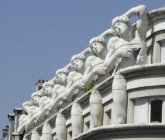Replicas of Michelangelo's Dying Slave pose on top of police headquarters.